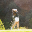 Brenden McFadden   Banner Nicole Warren, senior kinesiology major, tees off in a practice round at Eagle Glen Golf Course. The spring season will begin Feb. 8-9 at the Point Loma Nazarene University  Super San Diego Championship.