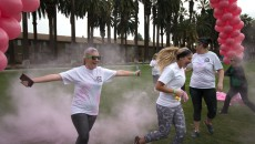 Lauren Shelburne   Banner Participants run through a cloud of pink powder while competing in the Start R.I.G.H.T Challenge 2016 3K Color Run Jan. 23. The Riverside Community Health Foundation has hosted this even since March 2012, this time on the Front Lawn of California Baptist University.