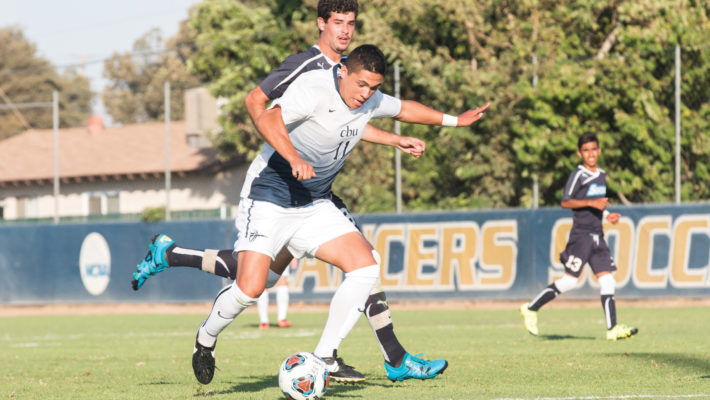 Hannah Tamimi | Banner Aidan Apodaca, junior biology major and forward, defends the ball in a match against Sonoma State University Sept. 8, in which California Baptist University's team Sonoma 2-1. Apodaca was named the PacWest Player of the Week after his contributions early in the season.