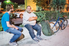 [Daren Stevens   Banner] Adam Goodman, senior biomedical engineering major, talks to a homeless man, Darryl*, regarding the Riverside ban on public camping. Darryl has been homeless for the past 28 years and has been forced to relocate because of the new rule against camping on public property.