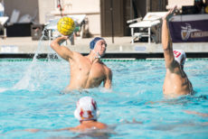 [Robert Jordan | The Banner] Brent Teraoka, senior biology major, fires the ball past Alex Waggoner of Claremont-Mudd-Scripps University in a match Sept. 23. The Lancers defeated the Stags 18-9.