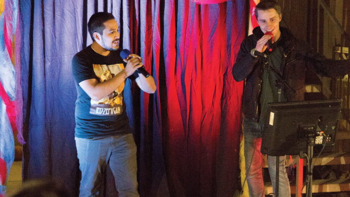 "[Abi Auer | Banner] Carlos Garcia (left), and Kaden Johnson, both senior mechanical engineering majors, sing ""Boheminan Rhapsody"" by Queen during the International Celebration Week Karaoke Night."