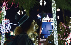 [John Victory | Banner] Ashlee Smith, junior communications disorders major, gazes at the Mission Inn Hotel & Spa light display in downtown Riverside. The festival will be running for its 24th year and feature favorite traditions, including a dazzling light display, food and entertainment.
